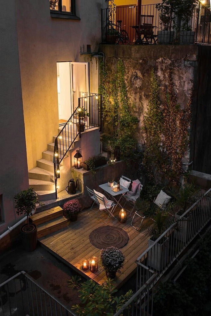 staircase leading to a balcony, small garden ideas, metal garden furniture, decorated with potted plants, crawling ivy