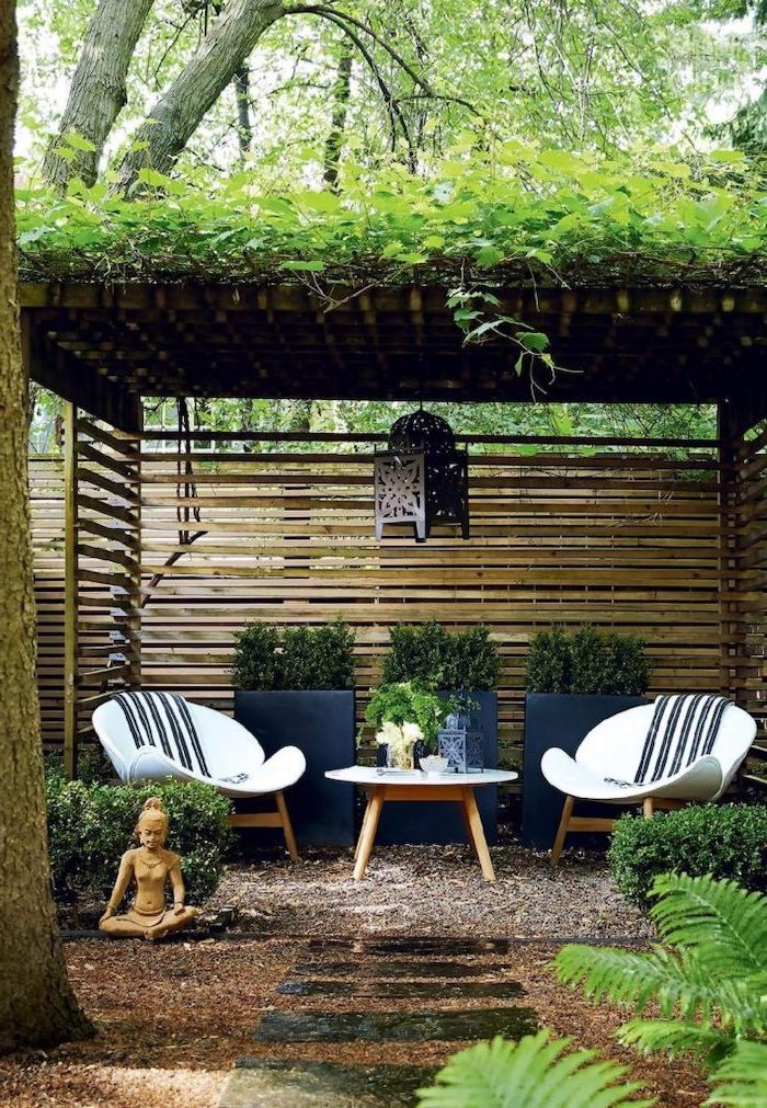 small garden shed, garden furniture underneath, garden design ideas, potted plants, tiled pathway