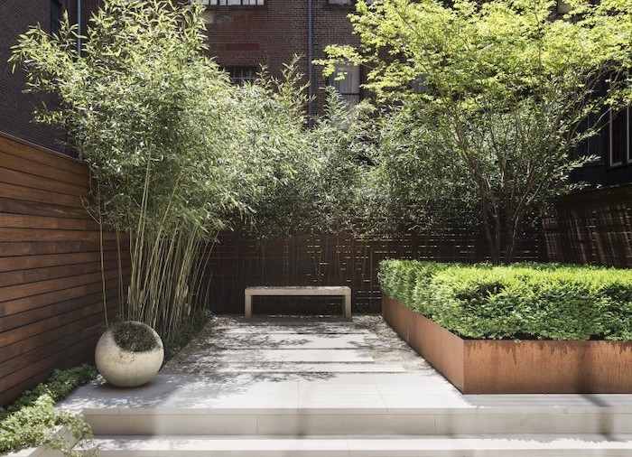 cement tiles, leading to a small bench, garden design ideas, planted trees and bushes around