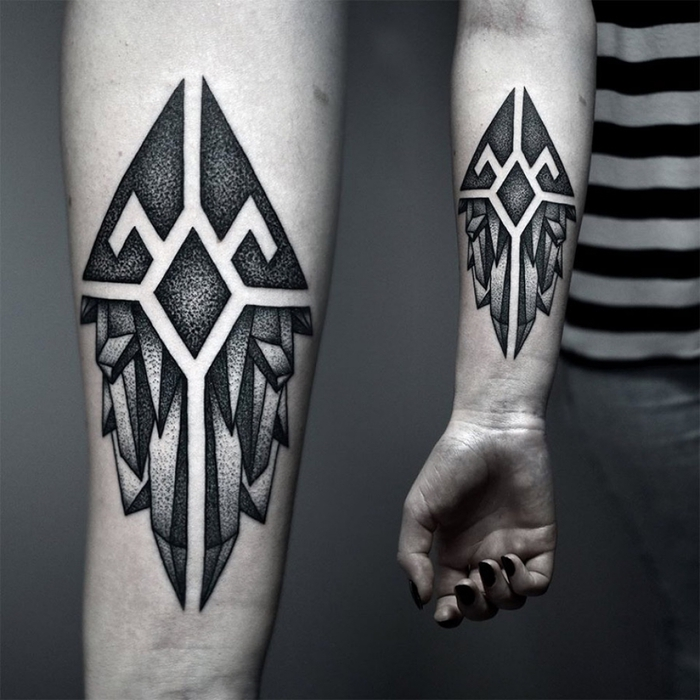 black nail polish, geometric animal tattoos, geometrical forearm tattoo, grey background
