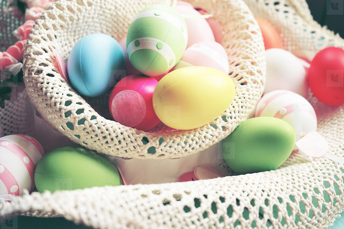 colourful eggs, inside a large sun hat, dying easter eggs with food coloring, eggs scattered everywhere