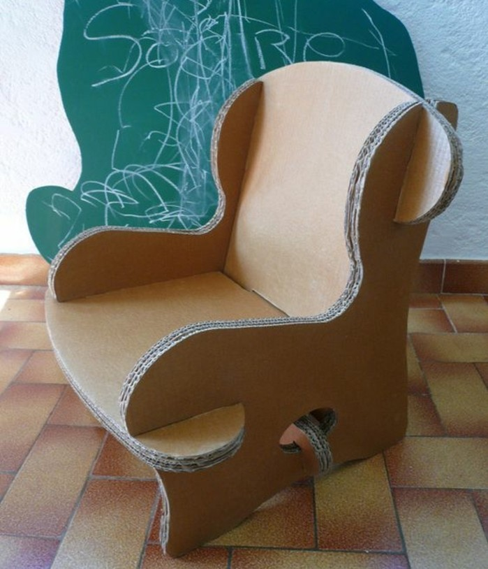 tiled floor, green chalkboard in the background, cardboard chair design, cardboard armchair