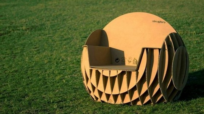 cardboard chair design, intricate round cardboard armchair, on green grass