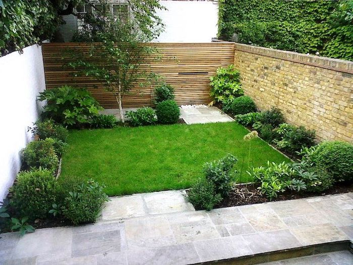 patch of grass, planted bushes and trees around, garden design ideas, cement tiled floor
