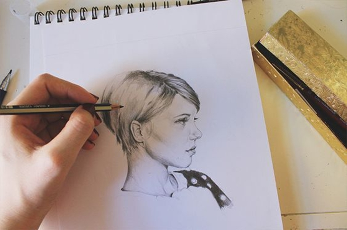 girl outline, black and white drawing, hand drawing, on a white sketchbook, girl with short hair