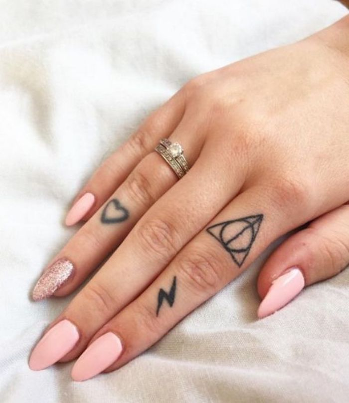 harry potter and the deathly hallows inspired, heart and lightning bolt, finger tattoos, small finger tattoos