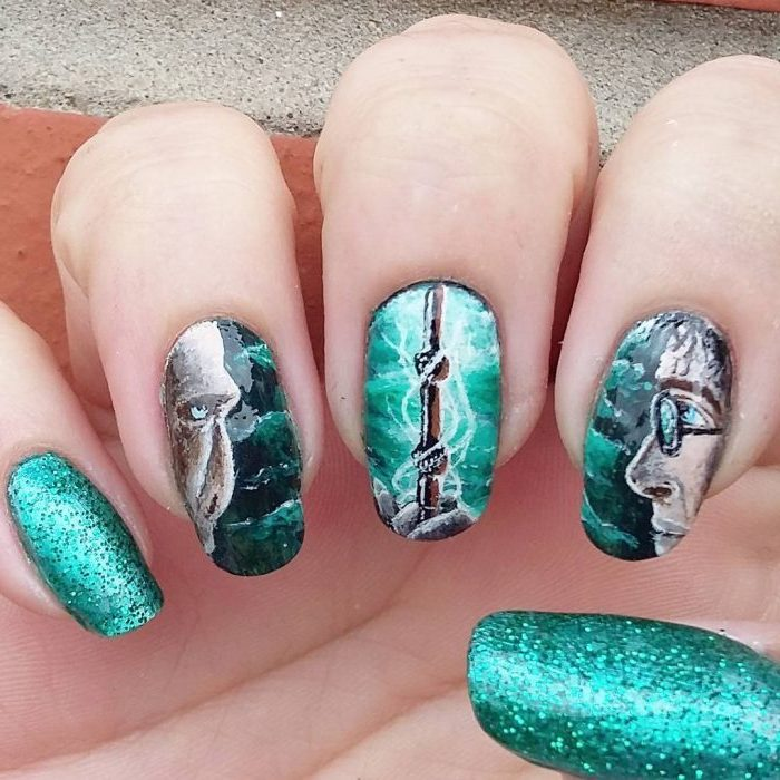 green nail polish, harry potter inspired manicure, nail color ideas, drawings of harry and voldemort, and the elder wand, cute nail designs for long nails