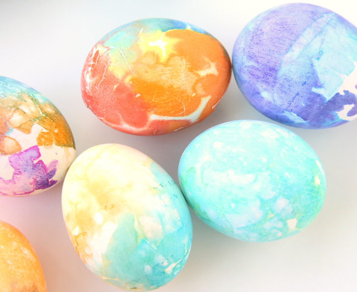 colourful dyed eggs, blue and red, purple and orange colours, dying easter eggs with food coloring
