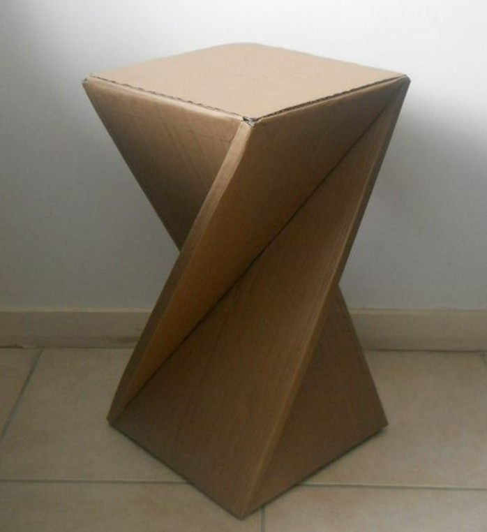 tiled floor, abstract design, cardboard stool, cardboard table, in front of a white wall, cardboard ideas