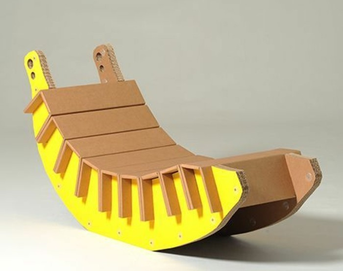 cardboard rocking chair, painted in yellow, in front of a white background, cardboard ideas