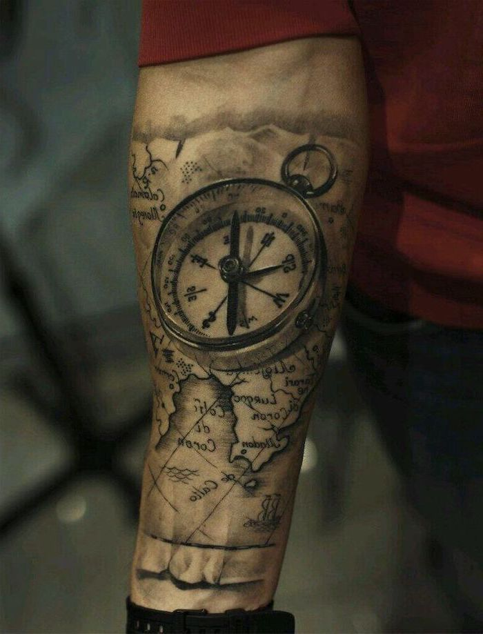 3d compass and map, forearm tattoo, back tattoos for men, man wearing red blouse