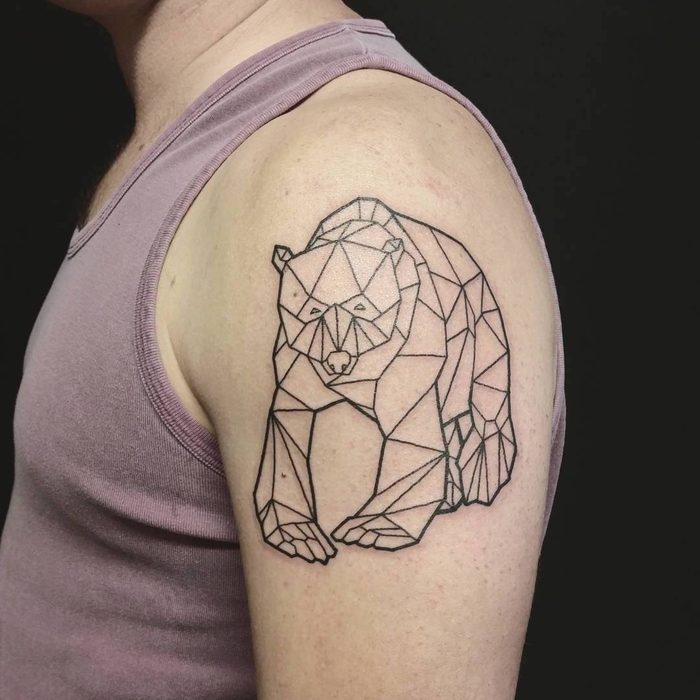 bear drawn with geometrical shapes, shoulder tattoo, pink tank top, geometric tattoo