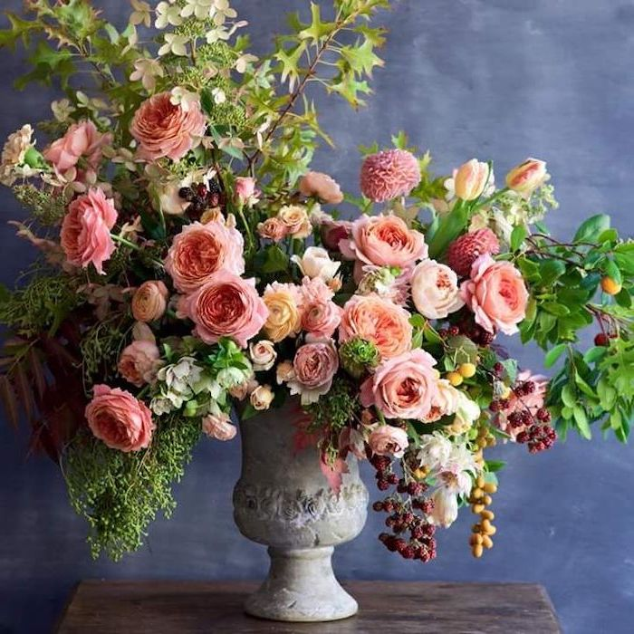 orange and yellow flowers, large flower bouquet, in a vintage vase, silk floral arrangements, on a wooden table