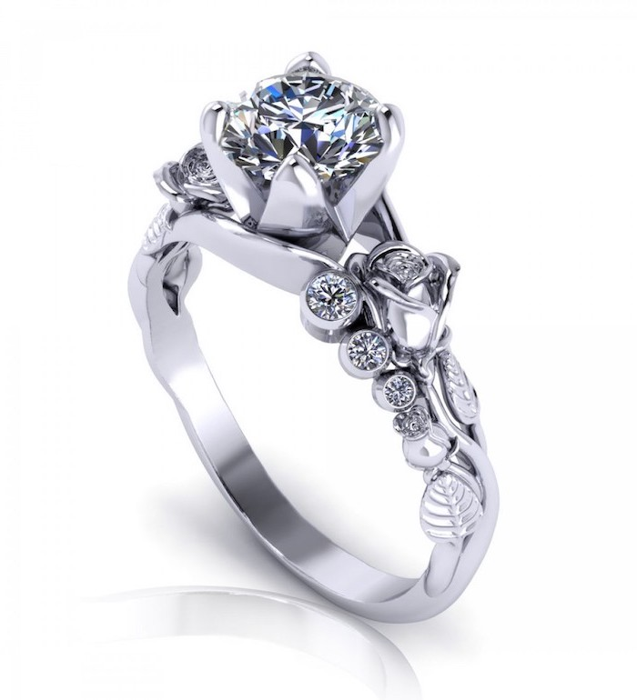 round diamond in the middle, white gold roses on the band, non traditional engagement rings
