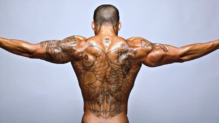 man spreading his arms, large koi fish, whole back tattoo, arm tattoos for men, shoulder tattoos, white background