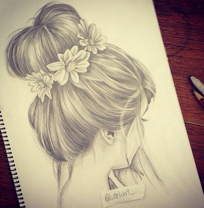 hair in a messy bun, flowers in the bun, black and white girl drawing, white sketchbook