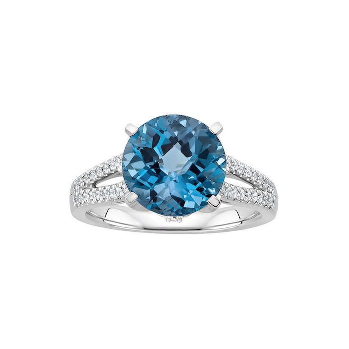 round blue sapphire, diamond studded band, non traditional engagement rings, white background