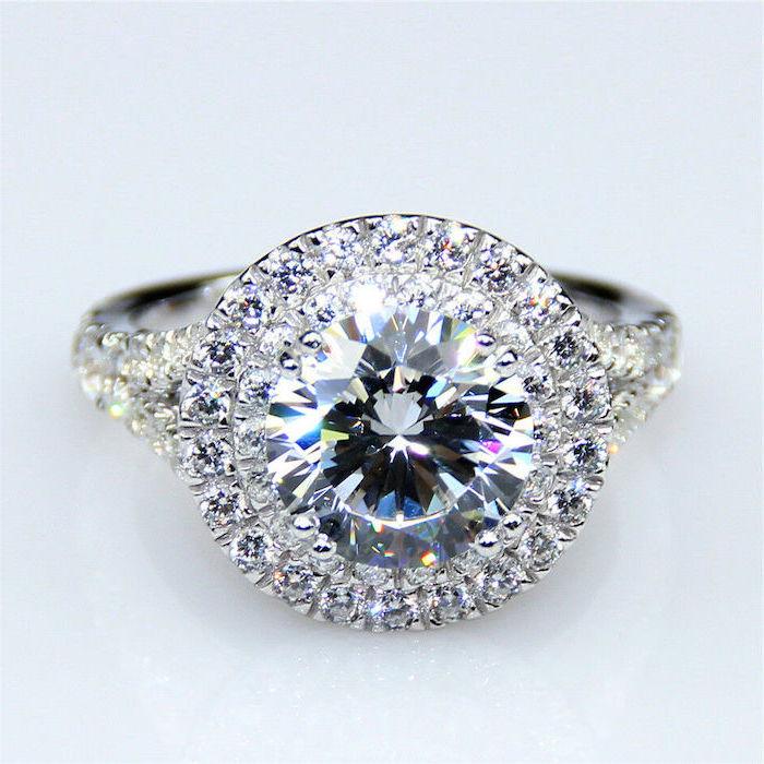 large round diamond, teardrop engagement ring, diamond studded band, white background