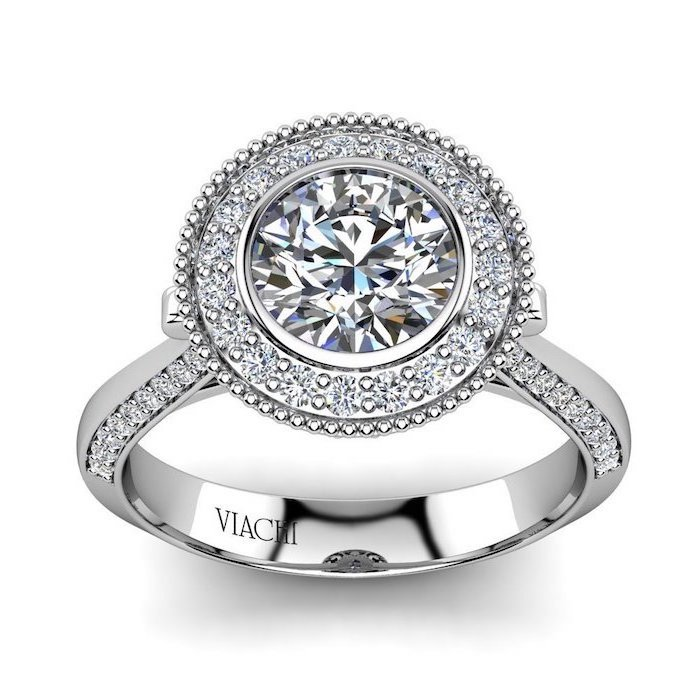large round diamond, surrounded by smaller diamonds, teardrop engagement ring, white gold band
