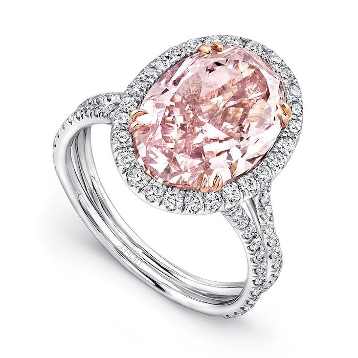 large morganite stone, surrounded by small diamonds, alternative engagement rings, diamond studded band