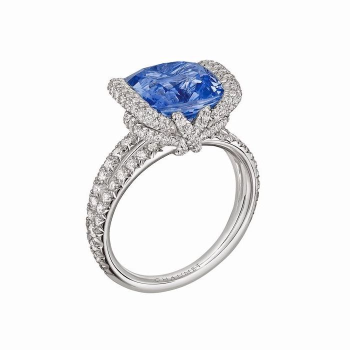 large sapphire, diamond studded band, alternative engagement rings, white background