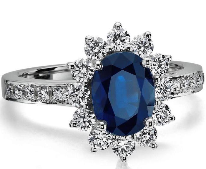 large sapphire, surrounded by diamonds in a flower shape, beautiful engagement rings