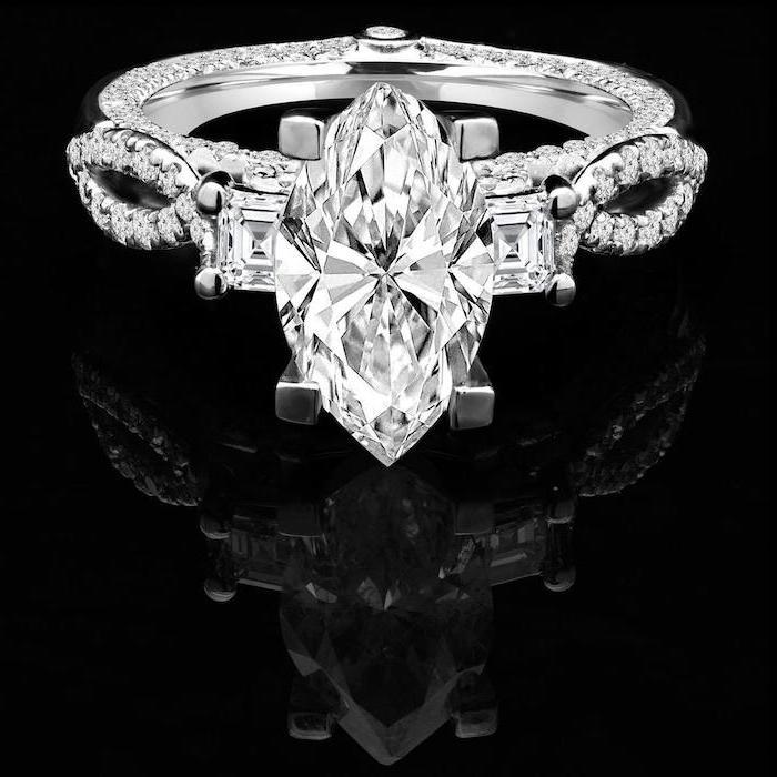 large diamond, black background, round halo engagement rings, diamond studded band