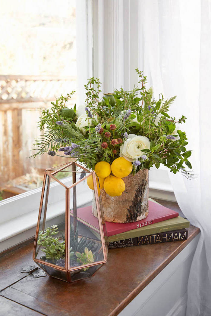 succulents in a hexagonal closed vase, flower arrangements, wooden vase, with lemons and greenery