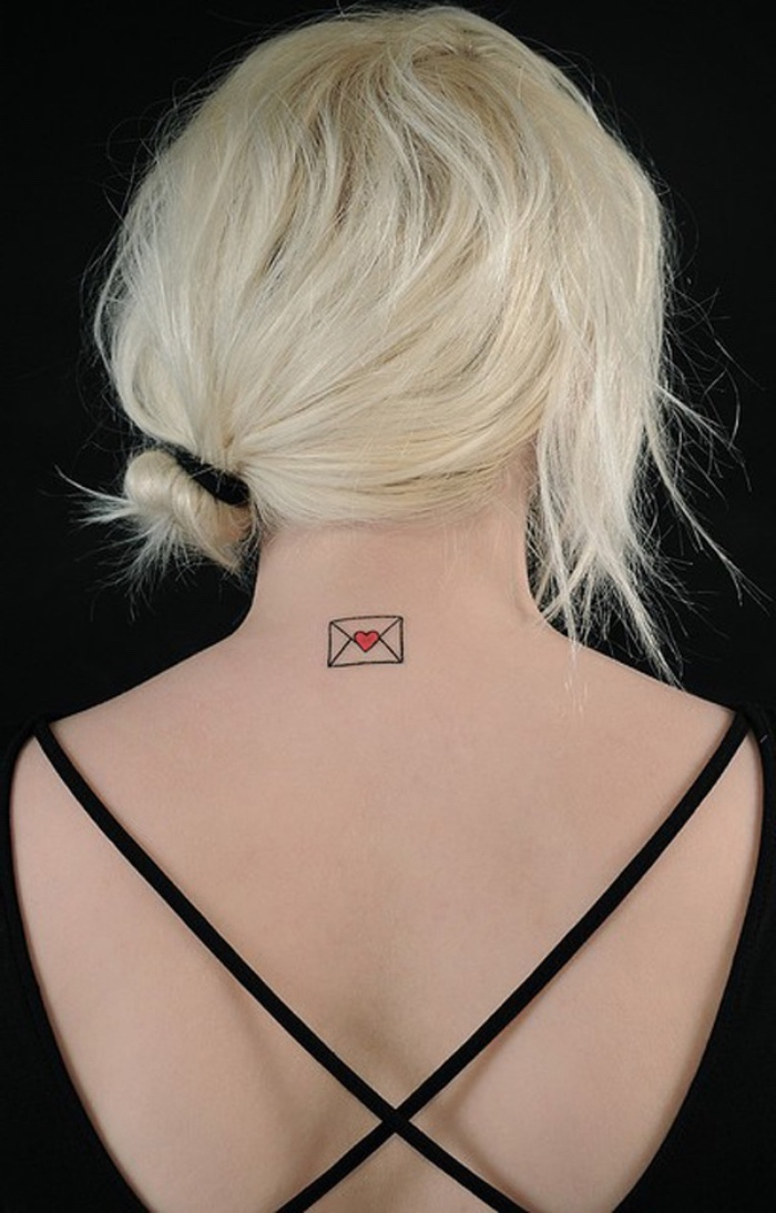 letter envelope with a heart back tattoo, woman with blonde hair, small bestfriend tattoos