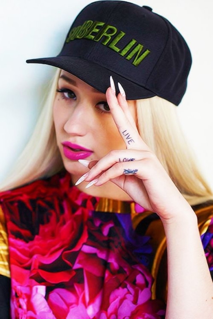 small tattoo ideas for men, live love crossed finger tattoos, iggy azalea staring at the camera, wearing a black cap