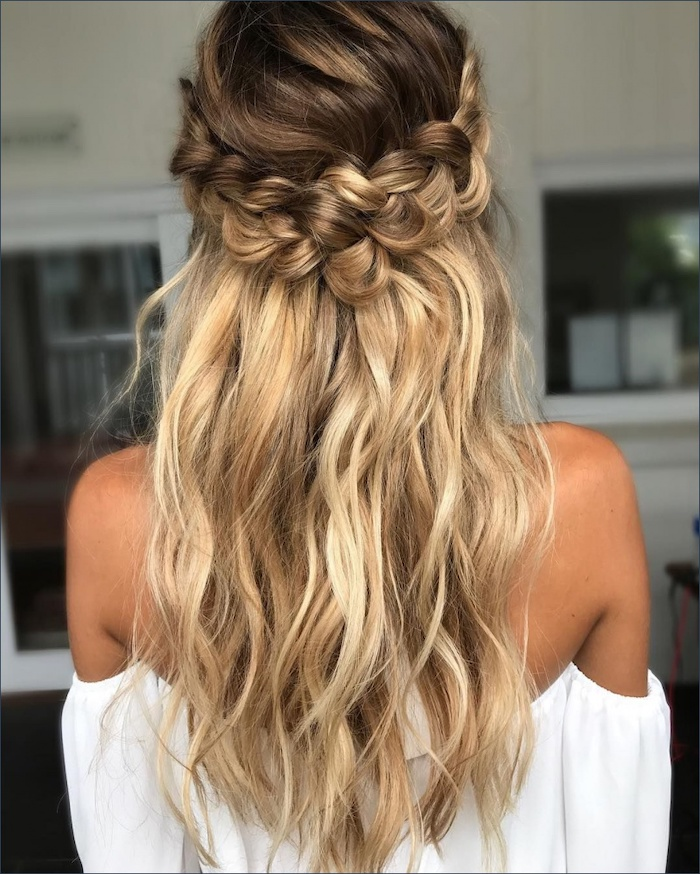 long blonde wavy hair, with a braid, white top, wedding hairstyle, blurred background