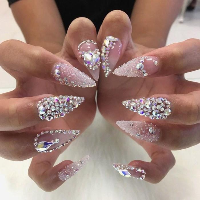 many crystals and stones on the nails, top coat nail polish, nail ideas, long stiletto nails