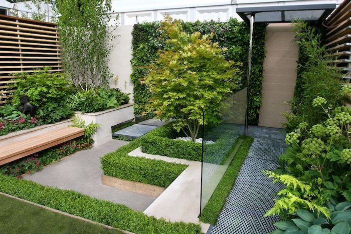 small wooden bench, surrounded by planted bushes and trees, garden patio ideas, planted small hedges