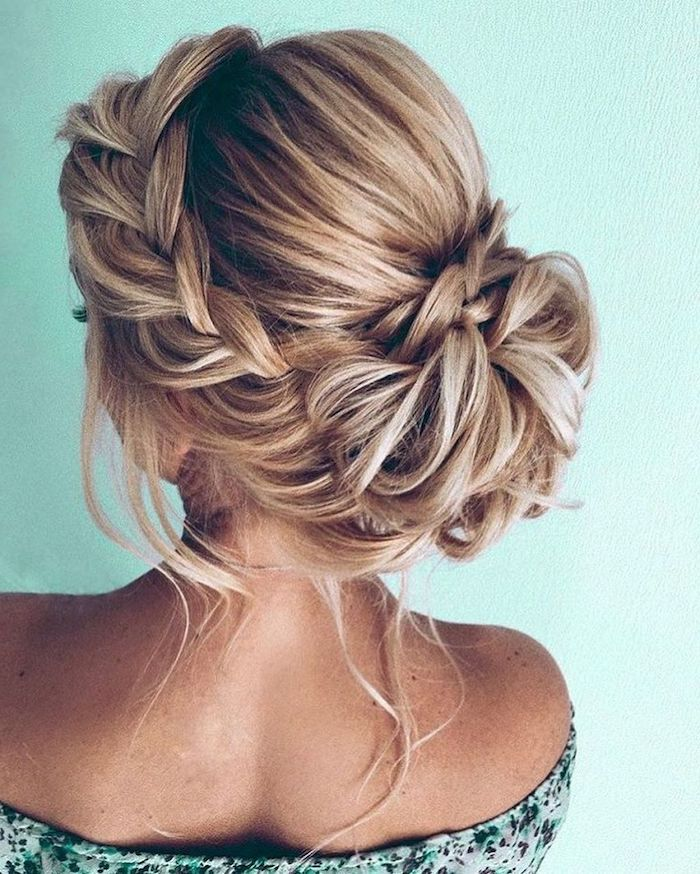 wedding hairstyle, low braided updo, blonde hair with highlights, floral top, green background