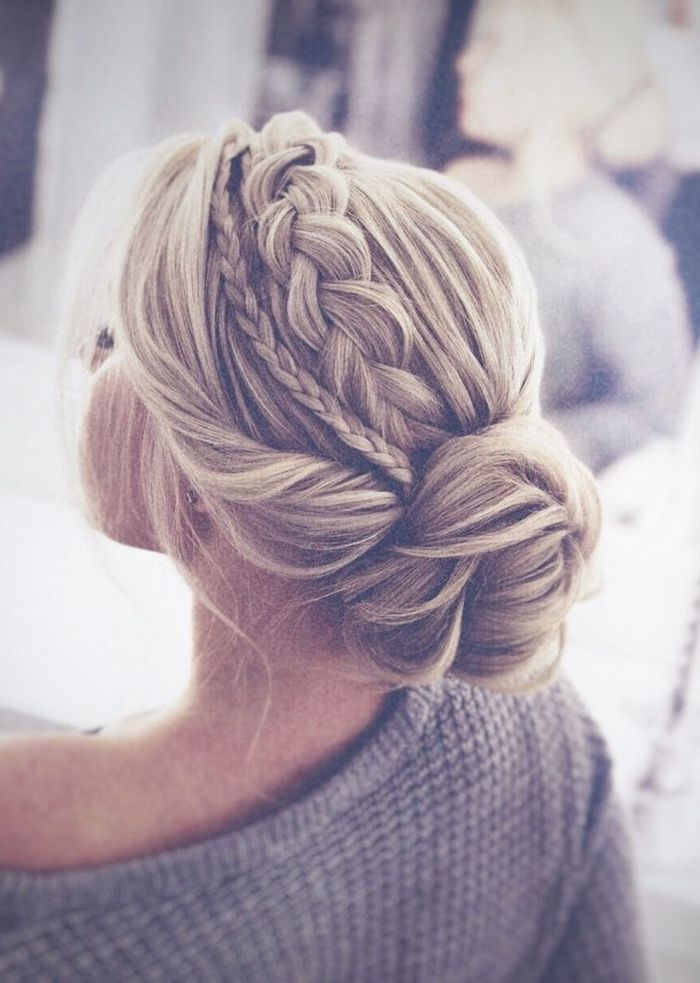 blonde hair in a low bun, small and big braid, grey sweater, wedding hairdos, blurred background