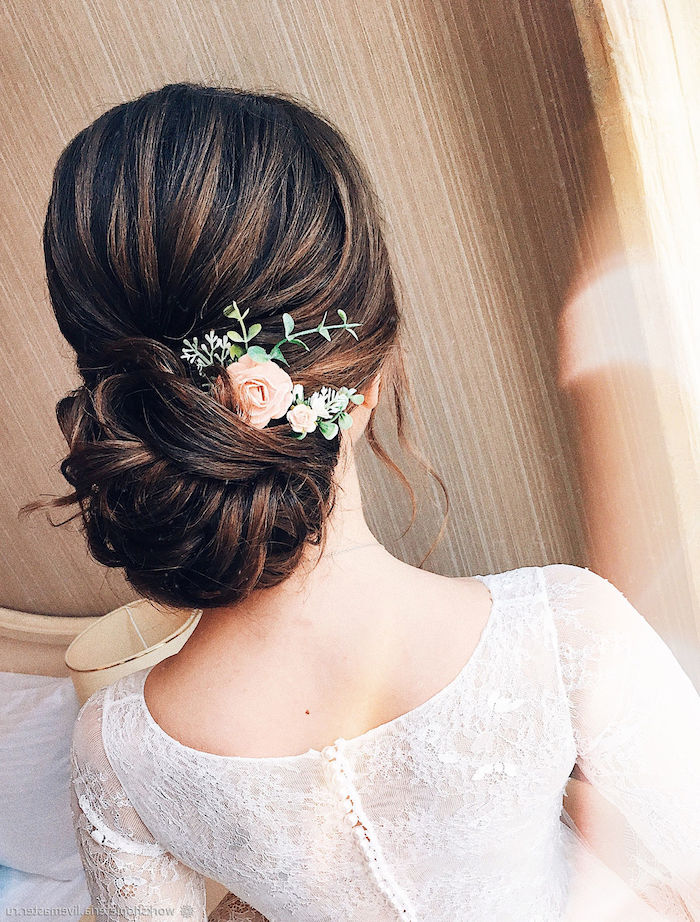 wedding hairdos, brown hair in a low updo, small flower hair accessory, white dress