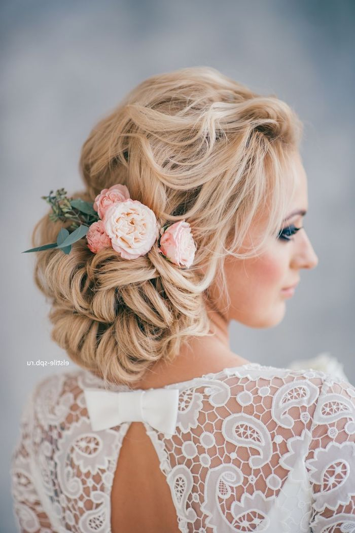 white dress with a bow, long blonde hair in a low updo, roses hair accessory, wedding hairdos