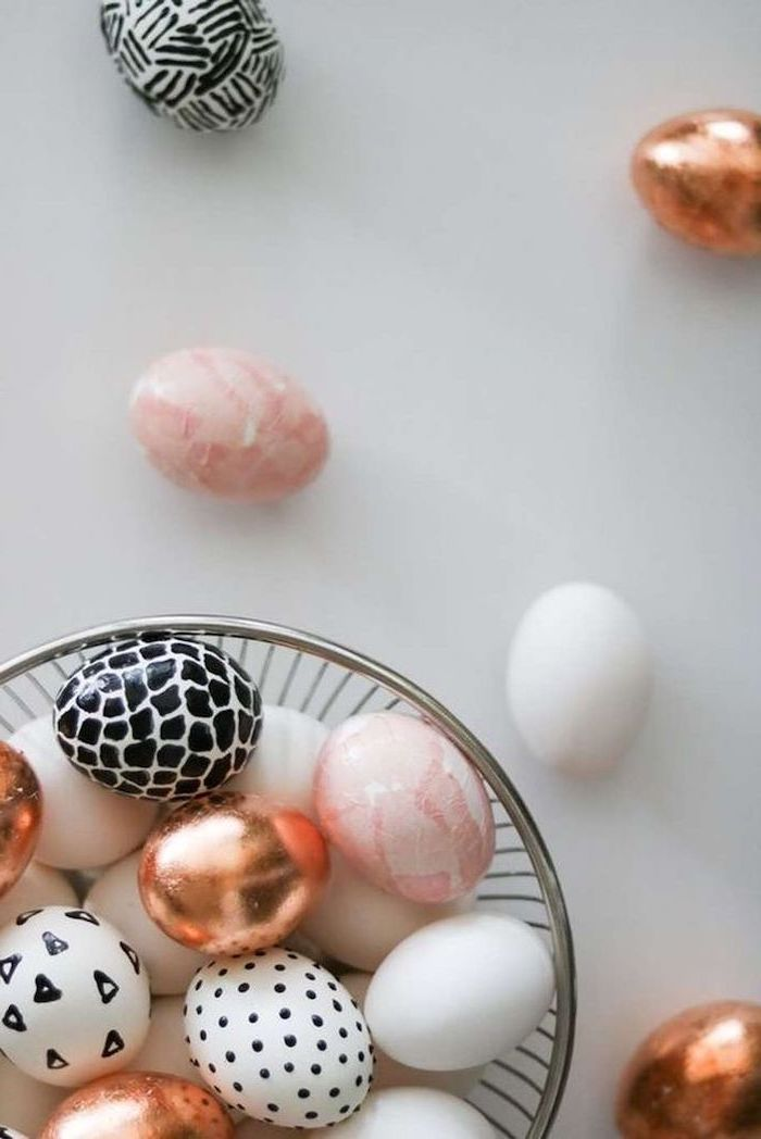 white background, easter egg coloring ideas, pink and rose gold, white and black, dyed eggs, metal bowl
