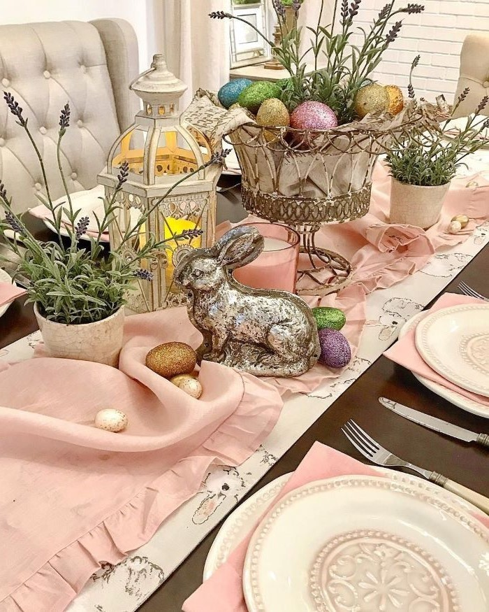 potted lavender, metal basket with dyed eggs, easter centerpiece ideas, pink table runner