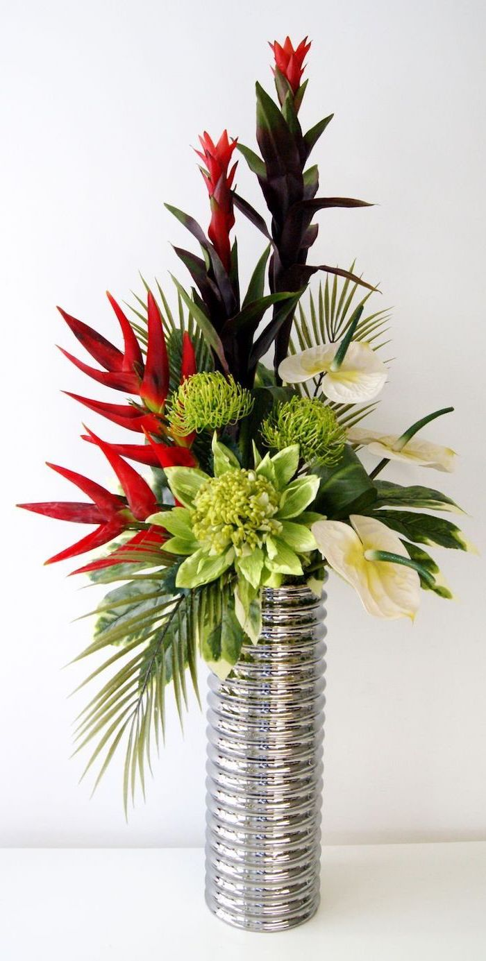 silver metal tall vase, flower arrangement ideas, lilies and red flowers bouquet, on a white countertop