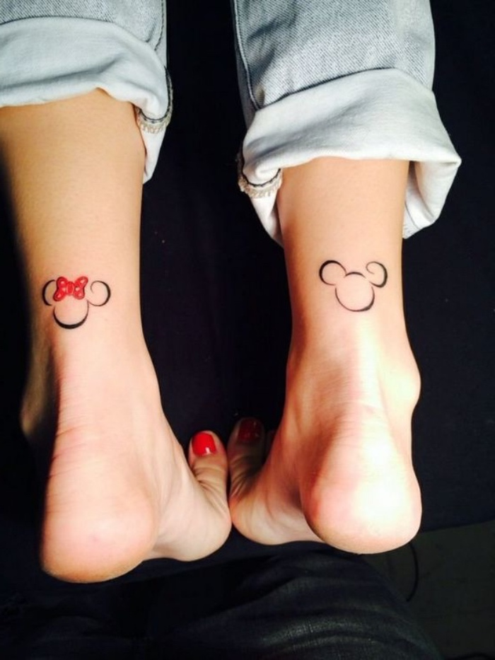 mickey and minnie ankle tattoo, woman wearing washed jeans, small tattoos for guys, red nail polish