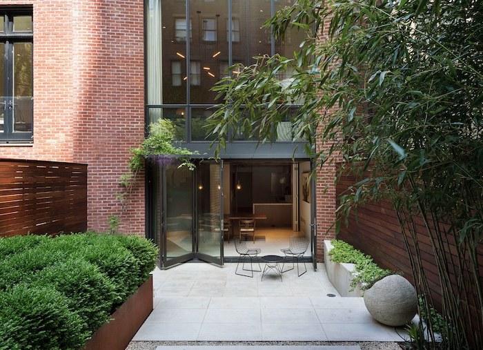 large tall windows, overlooking a small backyard, small backyard designs, black metal garden furniture