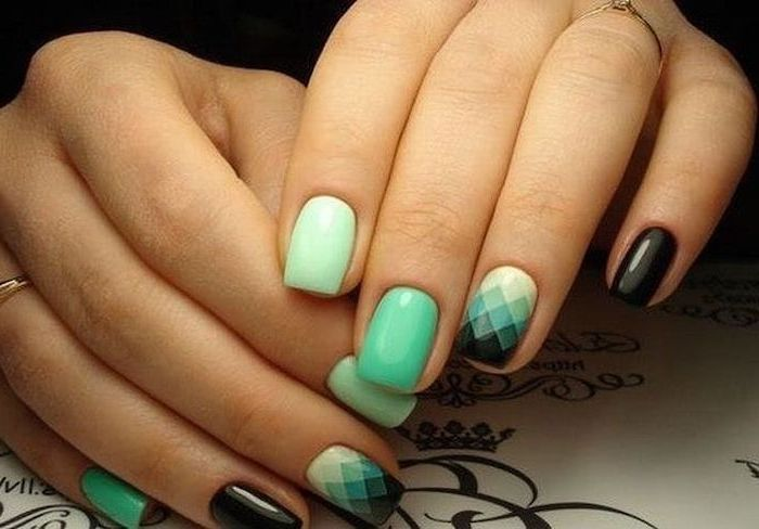 mint green and black nail polish, geometrical shapes on one of the nails, pretty nail designs, short squoval nails