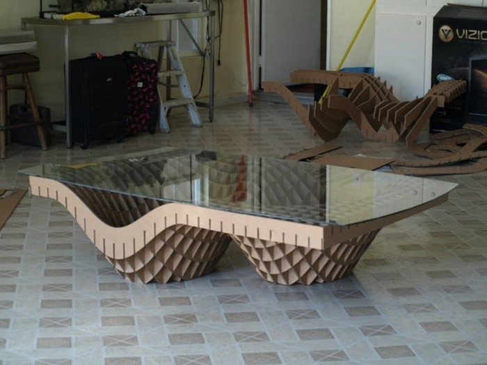 intricate design, coffee table, cardboard legs and a glass top, tiled floor, diy cardboard shelves