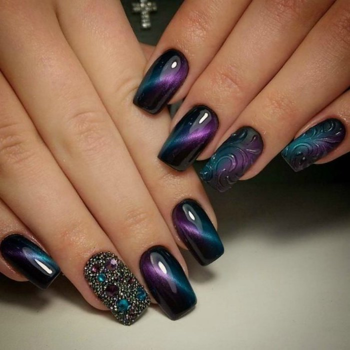 rhinestones on one of the nails, monochromatic nail polish, pretty nail designs, both hands photographed