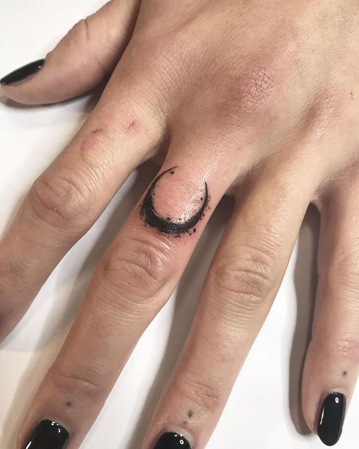 7d819c69f crescent moon tattoo, on the middle finger, finger tattoos, hand resting on  a Finger Tattoo: Over 70 cool themes and their meaning ...