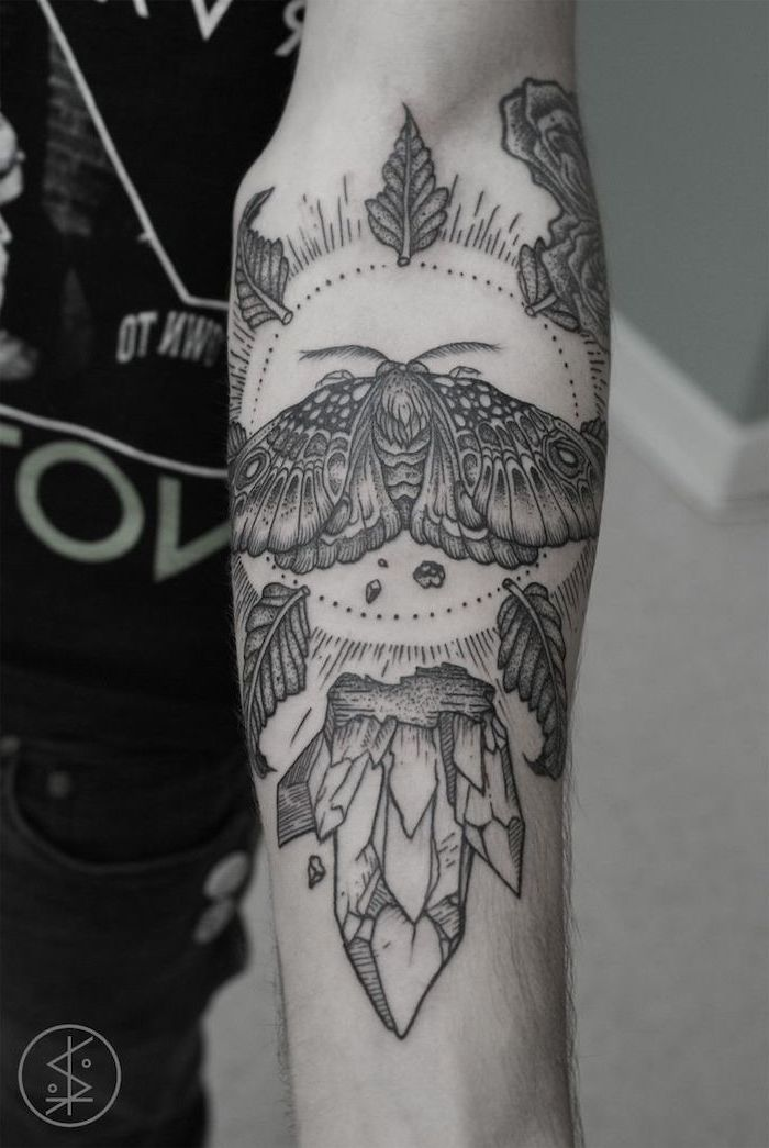 large moth, inside a circle, surrounded by roses and crystals, cool small tattoos, forearm tattoo