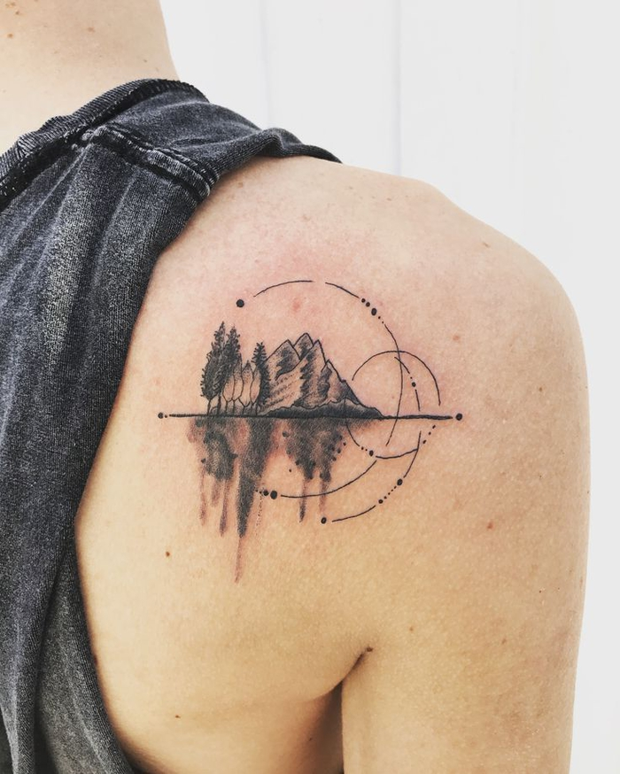 mountain landscape with circles, tattoo on the back of the shoulder, geometric flower tattoo