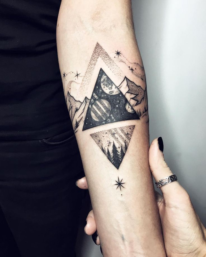 mountain landscape, with triangles and stars, tattoo on the forearm, geometric flower tattoo