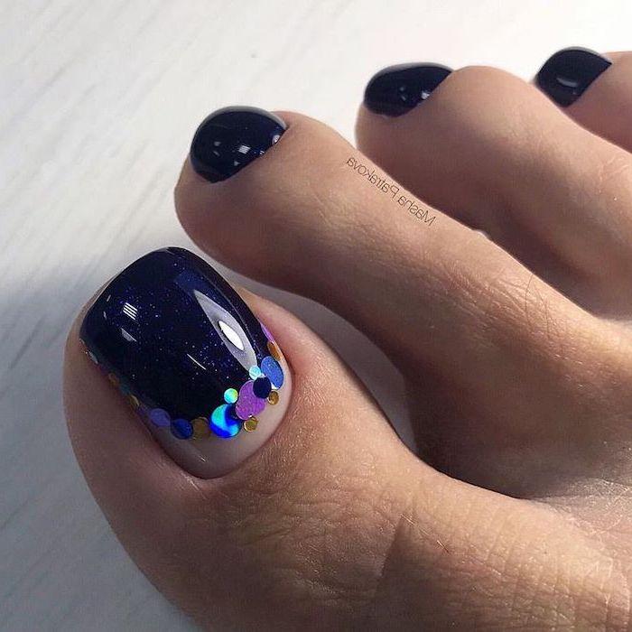 dark blue nail polish pedicure, colourful sequins on the toe, nude nail designs